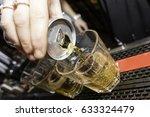 energy drink shot being poured... | Shutterstock . vector #633324479