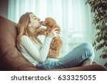 young girl is resting with a... | Shutterstock . vector #633325055
