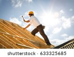 roofer working on roof... | Shutterstock . vector #633325685