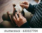 Girl's Hands Holding Euro Bill...