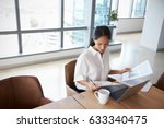 businesswoman working alone on... | Shutterstock . vector #633340475