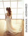 beautiful bride with wedding... | Shutterstock . vector #633344825