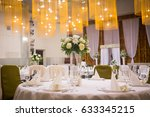 plate at the wedding table that ... | Shutterstock . vector #633345215