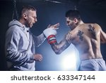 coach with boxer sparring on... | Shutterstock . vector #633347144