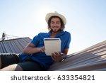 Happy Man Using Digital Tablet...