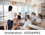 businesswoman leads meeting... | Shutterstock . vector #633364961