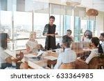 businesswoman leads meeting... | Shutterstock . vector #633364985