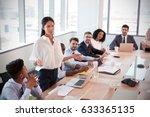 businesswoman stands to address ... | Shutterstock . vector #633365135