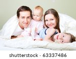 young happy family of four at... | Shutterstock . vector #63337486