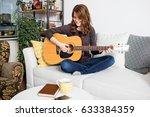 beautiful young woman sitting... | Shutterstock . vector #633384359