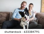 Stock photo beautiful couple relaxing at home and loving their pet 633384791