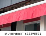red awning over windows of store   Shutterstock . vector #633395531