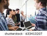 happy colleagues looking... | Shutterstock . vector #633413207