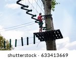 young man passes obstacles in... | Shutterstock . vector #633413669