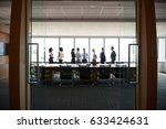 businesspeople stand and chat... | Shutterstock . vector #633424631