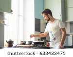 a man at home is cooking | Shutterstock . vector #633433475