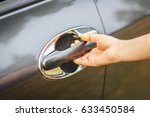woman pulls hand on car door. | Shutterstock . vector #633450584