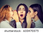 three young women telling... | Shutterstock . vector #633470375