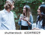 group of young friends talking... | Shutterstock . vector #633498029