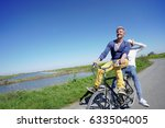 cheerful couple riding bike on...   Shutterstock . vector #633504005