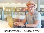 young asian hipster man using... | Shutterstock . vector #633525299