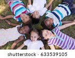 high angle portrait of smiling... | Shutterstock . vector #633539105