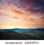 sunrise composition. hills of...