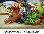 suckling pig on festive table. | Shutterstock . vector #633601685