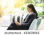 relaxed smiling woman using a... | Shutterstock . vector #633628061