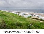 grassy hill overlooking a sandy ...   Shutterstock . vector #633632159