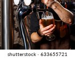 the bartender pours the beer... | Shutterstock . vector #633655721