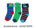 three childrens colored socks ... | Shutterstock . vector #633670499