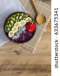 acai bowl with napkin and spoon | Shutterstock . vector #633675341