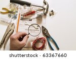 amateur tools with instruction booklet - stock photo