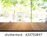 image of wooden table in front... | Shutterstock . vector #633703847