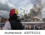 Small photo of MÉRIDA, VENEZUELA. OCTOBER 2016. Venezuelan people protests against their Government. This protest derived on violent acts. The smoke at the back comes from a police truck burned by demonstrators.