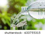 drinking water poured into the...   Shutterstock . vector #633755315