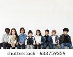 group of kids sitting... | Shutterstock . vector #633759329