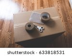 cardboard box and gum tape | Shutterstock . vector #633818531