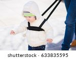 mothers teach to walk on the... | Shutterstock . vector #633835595