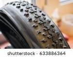 photo of studded bicycle tire   Shutterstock . vector #633886364