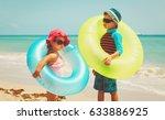 little boy and girl go swim on...