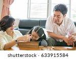 happy asian family having fun... | Shutterstock . vector #633915584