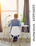 man sitting in home office and... | Shutterstock . vector #633916055