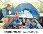 family having snacks outside... | Shutterstock . vector #633936041