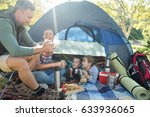 family interacting while having ... | Shutterstock . vector #633936065