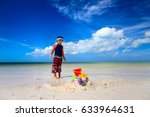 little boy play with sand on... | Shutterstock . vector #633964631