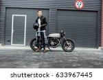 handsome rider biker man hold... | Shutterstock . vector #633967445