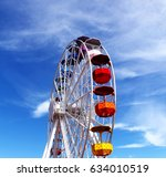 colorful ferris wheel in the sky | Shutterstock . vector #634010519