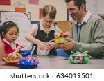 primary school teacher is... | Shutterstock . vector #634019501